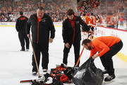 The Philadelphia Flyers ice crew picks up hat that were thrown on the ice following a hattrick by Claude Giroux #28 against the New York Rangers at the Wells Fargo Center on April 7, 2018 in Philadelphia, Pennsylvania. The Flyers shut out the Rangers 5-0.
