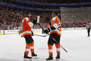 Claude Giroux #28 of the Philadelphia Flyers (r) scores on the powerplay at 12:24 of the second period against the New York Rangers and is joined by Sean Couturier #14 (l) at the Wells Fargo Center on April 7, 2018 in Philadelphia, Pennsylvania. The goal gave Giroux 100 points on the season.