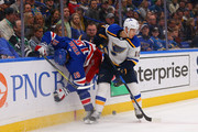Brayden Schenn #10 of the St. Louis Blues knocks Marc Staal #18 of the New York Rangers off the puck at the Scottrade Center on March 17, 2018 in St. Louis, Missouri.