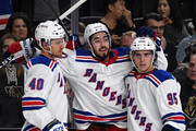 Mika Zibanejad (C) #93 of the New York Rangers celebrates with teammates Michael Grabner #40 and Vinni Lettieri #95 after Zibanejad scored a goal against the Vegas Golden Knights in the first period of their game at T-Mobile Arena on January 7, 2018 in Las Vegas, Nevada.