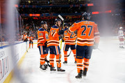 Matthew Benning #83, Connor McDavid #97, Leon Draisaitl #29 and Milan Lucic #27 of the Edmonton Oilers celebrate a goal against the New York Rangers at Rogers Place on March 3, 2018 in Edmonton, Canada.