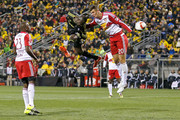 Kei Kamara #23 of the Columbus Crew SC heads the ball past Matt Miazga #20 of the New York Red Bulls during the first half on November 22, 2015 at MAPFRE Stadium in Columbus, Ohio.
