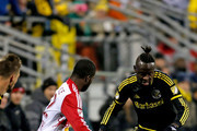 Kei Kamara #23 of the Columbus Crew SC drives the ball upfield against Kemar Lawrence #92 of the New York Red Bulls during the first half on November 22, 2015 at MAPFRE Stadium in Columbus, Ohio. Columbus defeated New York 2-0.
