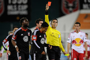 Andy Najar #14 of D.C. United is given a red card and ejected from the game by referee Jair Marrufo in the second half against the New York Red Bulls during their Eastern Conference Semifinal match at RFK Stadium on November 3, 2012 in Washington, DC.