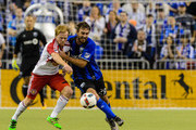 Dax McCarty #11 of the New York Red Bulls and Eric Alexander #29 of the Montreal Impact battle for the ball during the MLS game at the Olympic Stadium on March 12, 2016 in Montreal, Quebec, Canada.  The Montreal Impact defeated the New York Red Bulls 3-0.