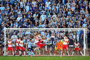 Seth Sinovic #15 of Sporting KC tries to score as Dax McCarty #11 of New York Red Bulls defends during the game at Sporting Park on March 8, 2015 in Kansas City, Kansas.