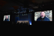 Artist Ai Weiwei (on screen) delivers a video message at the The New York Times International Luxury Conference at Mandarin Oriental on December 2, 2014 in Miami, Florida.