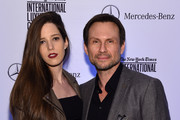 Christian Slater (R) and Brittany Lopez attend the Speaker Dinner presented by Mercedes-Benz during The New York Times International Luxury Conference at the Moore Building on December 1, 2014 in Miami, Florida.