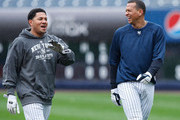 Melky Cabrera #53 and Alex Rodriguez #13 of the New York Yankees laugh in the outfield  during workouts  on October 15, 2009 at Yankee Stadium in the Bronx borough of New York City.