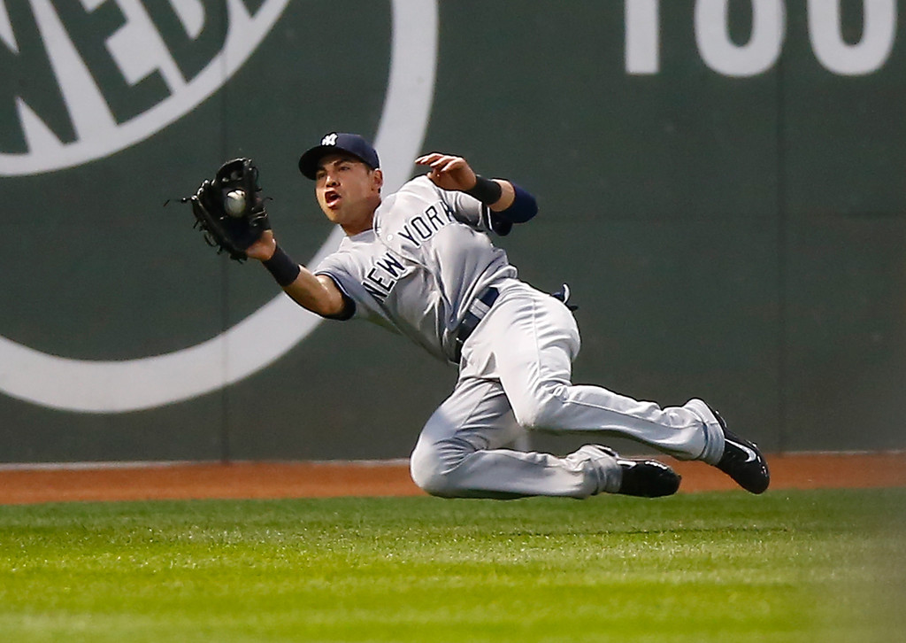 Jacoby Ellsbury fielding against the Boston Red Sox