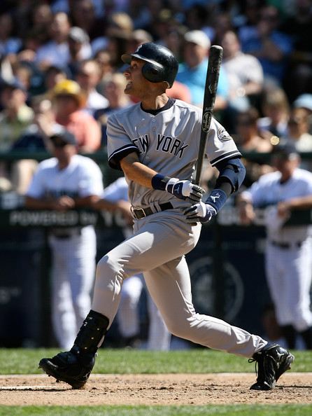 Derek Jeter #2 of the New York Yankees singles in the seventh inning against the Seattle Mariners on August 16, 2009 at Safeco Field in Seattle, Washington. The Mariners defeated the Yankees 10-3.