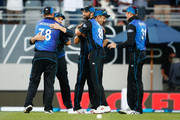 (L-R) Corey Anderson,Brendon McCullum, Grant Elliot, Trent Boult and Martin Guptill of New Zealand celebrate following the One Day International match between New Zealand and Australia at Eden Park on February 3, 2016 in Auckland, New Zealand.