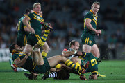 Jason Nightingale of the Kiwi's is tackled by Johnathan Thurston and Greg Inglis of the Kangaroos during the ANZAC Test match between the New Zealand Kiwis and the Australian Kangaroos at Eden Park on April 20, 2012 in Auckland, New Zealand.