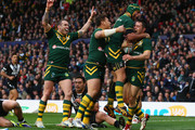 Cooper Cronk (R) of Australia celebrates scoring his sides second try with Johnathan Thurston during the Rugby League World Cup Final between Australia and New Zealand at Old Trafford on November 30, 2013 in Manchester, England.