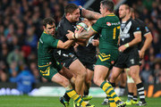 Jared Waerea-Hargreaves of New Zealand is trackled by Cameron Smith and Corey Parker of Australia during the Rugby League World Cup Final between New Zealand and Australia at Old Trafford on November 30, 2013 in Manchester, England.
