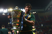 Johnathan Thurston of Australia poses with the winners trophy after his sides 34-2 victory during the Rugby League World Cup Final between Australia and New Zealand at Old Trafford on November 30, 2013 in Manchester, England.