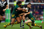 Kieran Foran (C) of New Zealand is tackled by Sam Thaiday (L) and Cooper Cronk of Australia during the Rugby League World Cup final between New Zealand and Australia at Old Trafford on November 30, 2013 in Manchester, England.