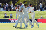 Stuart Broad of England (C) is congratulated by team mates after dismissing Kane Williamson of New Zealand during day five of the Second Test match between New Zealand and England at Hagley Oval on April 3, 2018 in Christchurch, New Zealand.