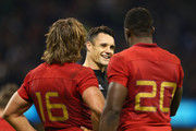 Dan Carter of the New Zealand All Blacks is congratulated by Dimitri Szarzewski of France and Yannick Nyanga of France following the 2015 Rugby World Cup Quarter Final match between New Zealand and France at the Millennium Stadium on October 17, 2015 in Cardiff, United Kingdom.