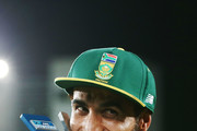 Imran Tahir of South Africa celebrates with the T20 trophy after winning the first International Twenty20 match between New Zealand and South Africa at Eden Park on February 17, 2017 in Auckland, New Zealand.