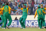 Imran Tahir (L) of South Africa celebrates the wicket of Jesse Ryder of New Zealand during the 2011 ICC World Cup Quarter-Final match between New Zealand and South Africa at Shere-e-Bangla National Stadium on March 25, 2011 in Dhaka, Bangladesh.