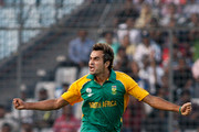 Imran Tahir of South Africa celebrates the wicket of Jesse Ryder of New Zealand caught during 2011 ICC World Cup Quarter-Final match between New Zealand and South Africa at Shere-e-Bangla National Stadium on March 25, 2011 in Dhaka, Bangladesh.
