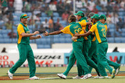 Jaques Kallis (L) of South Africa celebrates with team mates led by Imran Tahir (2nd L) after catching Ross Taylor of New Zealand during 2011 ICC World Cup Quarter-Final match between New Zealand and South Africa at Shere-e-Bangla National Stadium on March 25, 2011 in Dhaka, Bangladesh.