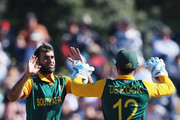 Imran Tahir of South Africa celebrates the wicket of Brendon McCullum of New Zealand during the One Day International match between New Zealand and South Africa at Bay Oval on October 24, 2014 in Mount Maunganui, New Zealand.