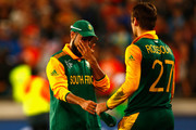 Imran Tahir of South Africa (L) shows his dejection following the 2015 Cricket World Cup Semi Final match between New Zealand and South Africa at Eden Park on March 24, 2015 in Auckland, New Zealand.