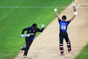 Daniel Vettori of New Zealand and Grant Elliott of New Zealand celebrate winning the 2015 Cricket World Cup Semi Final match between New Zealand and South Africa at Eden Park on March 24, 2015 in Auckland, New Zealand.
