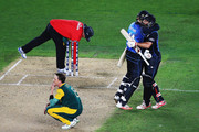 Dale Steyn of South Africa looks on as Daniel Vettori of New Zealand and Grant Elliott of New Zealand celebrate winning the 2015 Cricket World Cup Semi Final match between New Zealand and South Africa at Eden Park on March 24, 2015 in Auckland, New Zealand.