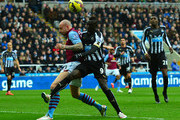 Papiss Cisse of Newcastle United takes on Alan Hutton of Aston Villa during the Barclays Premier League match between Newcastle United and Aston Villa at St James' Park on February 28, 2015 in Newcastle upon Tyne, England.
