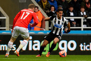 Hatem Ben Arfa of Newcastle goes past Aron Gunnarsson of Cardiff during the Budweiser FA Cup third round match between Newcastle United and Cardiff City at St James' Park on January 4, 2014 in Newcastle upon Tyne, England.