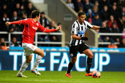 Hatem Ben Arfa of Newcastle is pursued by Peter Whittingham of Cardiff during the Budweiser FA Cup third round match between Newcastle United and Cardiff City at St James' Park on January 4, 2014 in Newcastle upon Tyne, England.