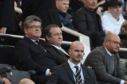 Newcastle owner Mike Ashley (c) flanked by Keith Bishop (l) and Lee Charnley look on from the stand during the Premier League match between Newcastle United and Leicester City at St. James Park on September 29, 2018 in Newcastle upon Tyne, United Kingdom.