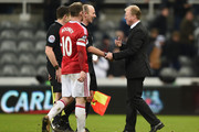 Steve McLaren manager of Newcastle United shakes hands with referee Mike Dean after the Barclays Premier League match between Newcastle United and Manchester United at St James' Park on January 12, 2016 at Newcastle upon Tyne, England.