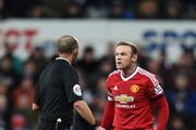 Referee Mike Dean and Wayne Rooney of Manchester United in discussion during the Barclays Premier League match between Newcastle United and Manchester United at St James' Park on January 12, 2016 at Newcastle upon Tyne, England.