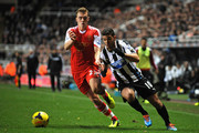 Hatem Ben Arfa of Newcastle United looks to get around Calum Chambers of Southampton during the Barclays Premier League match between Newcastle United and Southampton at St James' Park on December 14, 2013 in Newcastle upon Tyne, England.