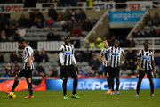 A dejected Hatem Ben Arfa, Papiss Demba Cisse and Vurnon Anita of Newcastle United  look on after the fourth goal during the Barclays Premier League match between  Newcastle United and Tottenham Hotspur at St James' Park on February 12, 2014 in Newcastle upon Tyne, England.