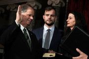 U.S. Sen. Doug Jones (D-AL) (L) participates in a mock swearing-in ceremony as Jones' wife Louise (R) and son Carson (2nd L) look on at the Old Senate Chamber of the U.S. Capitol January 3, 2018 in Washington, DC. Jones is the first Democratic senator from Alabama in more than two decades. He defeated Roy Moore leaving Republicans with a 51-49 majority in the U.S. Senate.