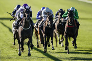 Ryan Moore riding Byron Flyer (L) win The Weatherbys General Stud Book Handicap Stakes at Newmarket Racecourse on September 27, 2018 in Newmarket, United Kingdom.