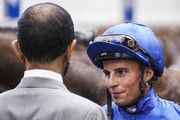 Jockey William Buick chats with Sheikh Mohammed bin Rashid Al Maktoum at Newmarket Racecourse on July 14, 2018 in Newmarket, United Kingdom.