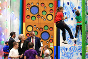 British Prime Minister Theresa May watches Norr Fatima, aged 10, as she descends the climbing wall during a visit to the Leisure Box, while on the local elections campaign on April 25, 2019 in Brierfield, Lancashire.