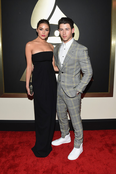 The 57th Annual GRAMMY Awards - Red Carpet [red carpet,flooring,carpet,formal wear,red carpet,fashion,suit,fun,event,tuxedo,haute couture,nick jonas,actor,olivia culpo,california,los angeles,staples center,57th annual grammy awards,the 57th annual grammy awards]