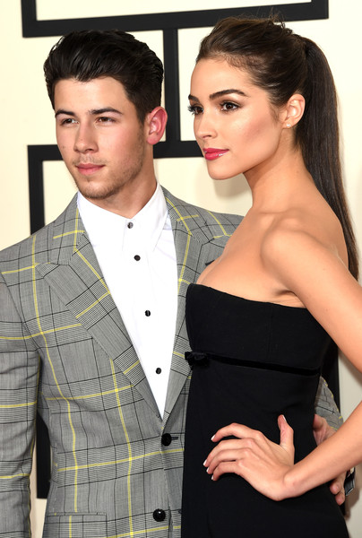 57th GRAMMY Awards - Arrivals [hair,suit,clothing,hairstyle,formal wear,beauty,tuxedo,fashion,outerwear,model,arrivals,nick jonas,olivia culpo,grammy awards,california,los angeles,staples center,l,the 57th annual grammy awards]