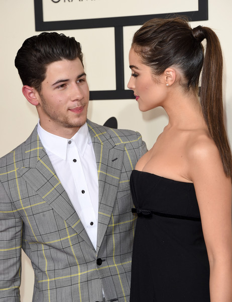 57th GRAMMY Awards - Arrivals [hair,suit,hairstyle,formal wear,fashion,tuxedo,forehead,outerwear,white-collar worker,premiere,arrivals,nick jonas,olivia culpo,grammy awards,california,los angeles,staples center,l,the 57th annual grammy awards]