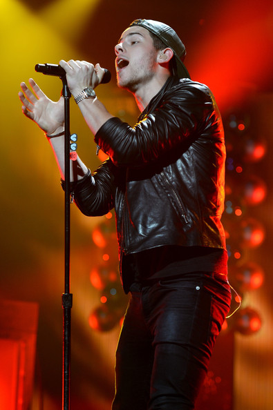 Y100's Jingle Ball Show [performance,entertainment,music artist,performing arts,singing,singer,music,microphone,red,musician,nick jonas,miami,fl,bb t center,y100,jingle ball 2014 - show]