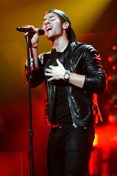 Y100's Jingle Ball Show [performance,entertainment,music artist,singing,music,performing arts,microphone,singer,musician,song,nick jonas,miami,fl,bb t center,y100,jingle ball 2014 - show]