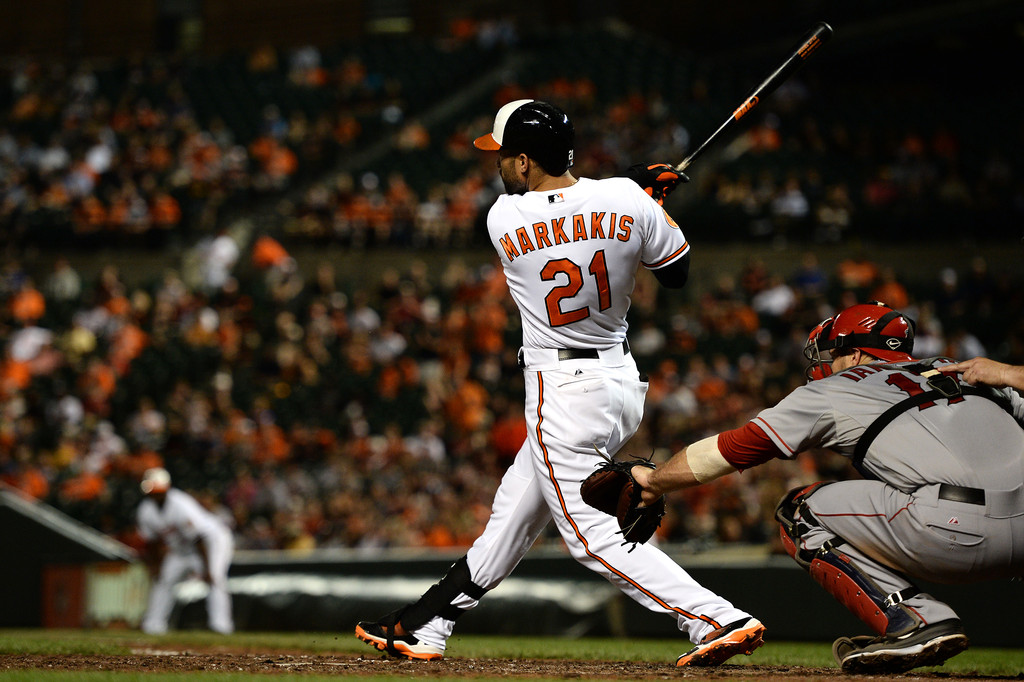 Nick Markakis #21 of the Baltimore Orioles hits a two-run single in the seventh inning against the Los Angeles Angels of Anaheim at Oriole Park at Camden Yards on June 11, 2013 in Baltimore, Maryland. The Baltimore Orioles won, 3-2.