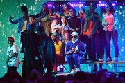 Pharrell Williams, Shay Haley and Chad Hugo perform with dancers  onstage at Nickelodeon's 2018 Kids' Choice Awards at The Forum on March 24, 2018 in Inglewood, California.